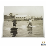 Vintage Female & Male Golfers Crossing River on Aquaplanes with Clubs & Bags 8x10 Wire Photo