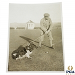 Mr. Gordon-Lockhart with Famous Prize Spaniel (Lord Reddy) Golf Ball Finder at Gleneagles Wire Photo